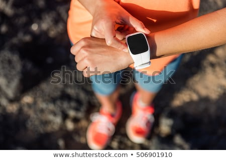 Sporty woman using activity tracker Stock photo © deandrobot