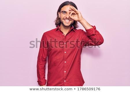 ストックフォト: ハンサム · 若い男 · 見える · 指 · 顔 · 髪