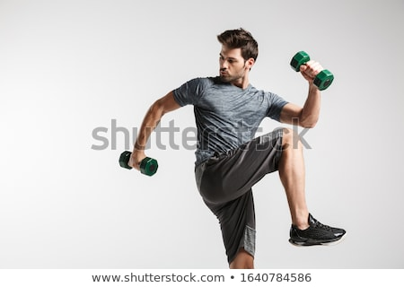 Man exercising with dumbbels isolated on white Stock photo © Elnur