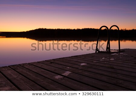 Night swim dock and calm lake at twilight Stock photo © Juhku