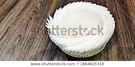 Tissue paper in bucket on wooden table Stock photo © nalinratphi