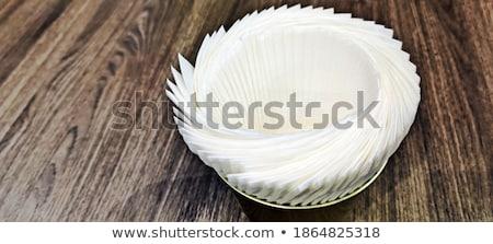 tissue paper in bucket on wooden table stock photo © nalinratphi