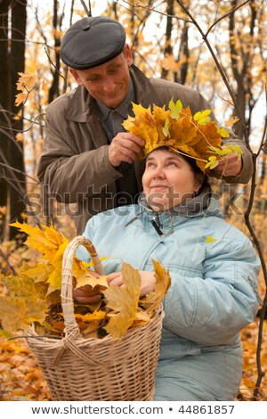 Old man put on his wife wreath of maple leaves Stock photo © Paha_L