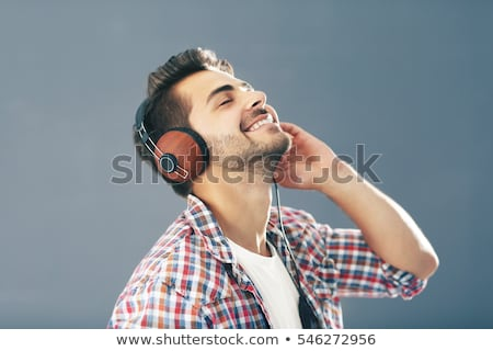 boy listening music in headphones Stock photo © Mikko