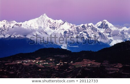 Tibet snow mountain with Grassland Stock photo © paulwongkwan