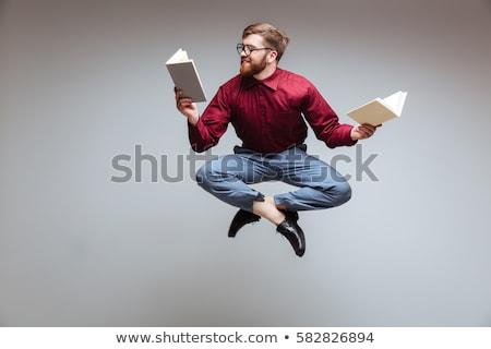 barbudo · homem · leitura · livro · isolado · cinza - foto stock © patramansky