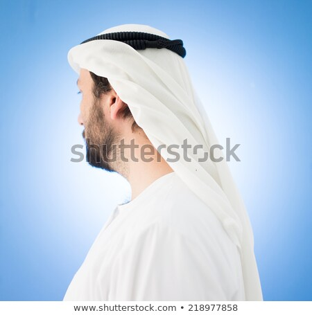 Arabic man with traditional clothes and headscarf wheel Stock photo © zurijeta
