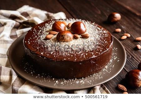 Cake with almonds and chocolate glaze Stock photo © user_11056481