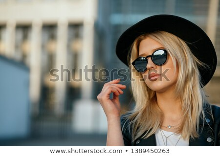 Portrait of a blonde wearing a fabulous hat Stock photo © konradbak