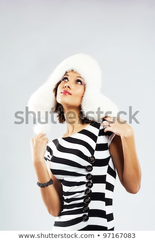young pretty woman in elegant strip dress isolated on white Stock photo © iordani