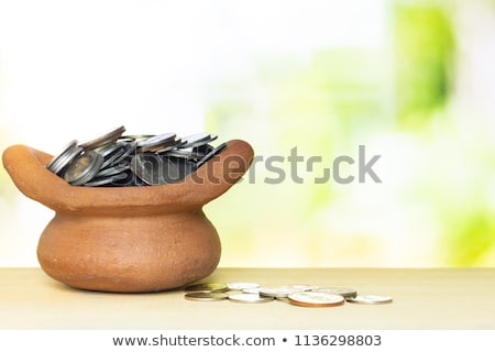 Green pot full of gold coins stock photo © orensila