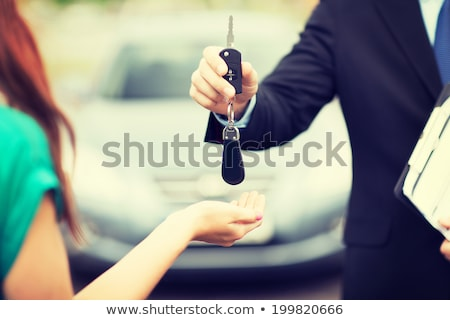 transportation and ownership concept - customer and salesman wit Stock photo © snowing