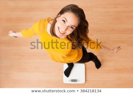 Boldog fiatal lány állt a mérleg Stock fotó © lithian