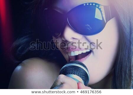 красивой · пения · женщину · лице - Сток-фото © keeweeboy