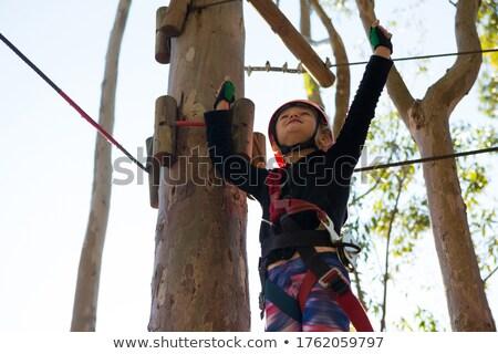 Stock fotó: Kislány · visel · sisak · kezek · égbolt · erdő