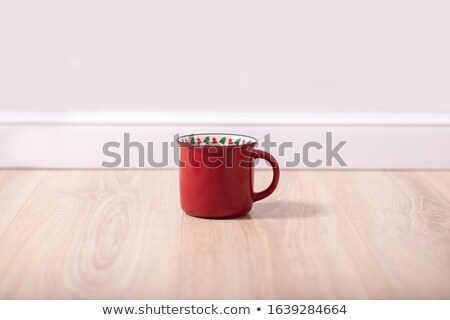 White Mug on Wooden Floor Against Wall Stock photo © make