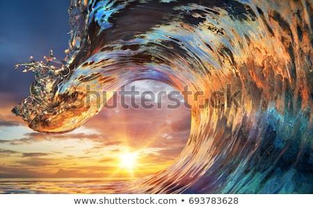 oranje · zonsondergang · zonnestralen · mooie · donkere · wolken - stockfoto © vapi