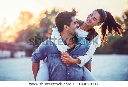 A young couple having fun by a lake Stock photo © IS2