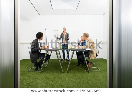 Man in an office with green carpet Stock photo © IS2