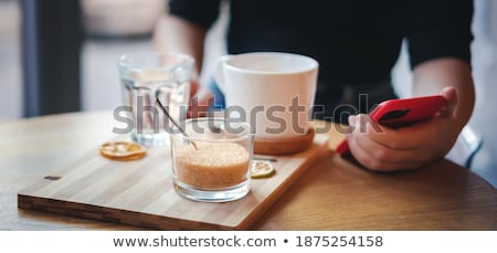 Woman touching bowl of sugar Stock photo © IS2