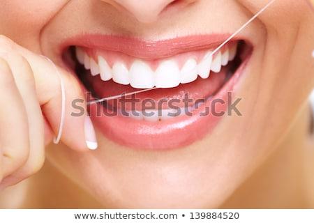 Vrouw flosdraad glimlachend geluk witte achtergrond Stockfoto © IS2