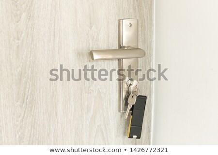 Anahtar içinde ahşap ev gümüş asılı Stok fotoğraf © FOTOYOU