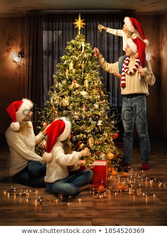 Christmas hat and baubles around gifts Stock photo © dash