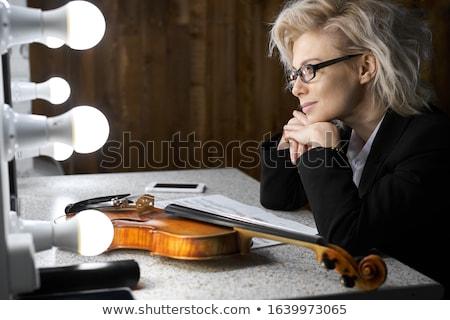 Genç kız oturma tablo kız lies açık kitap Stok fotoğraf © Traimak