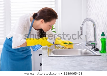 Female Janitor Cleaning Kitchen Sink Stock photo © AndreyPopov