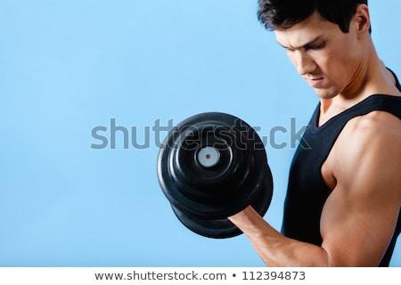 若い男 · 行使 · ダンベル · 上腕二頭筋 · ダンベル - ストックフォト © boggy