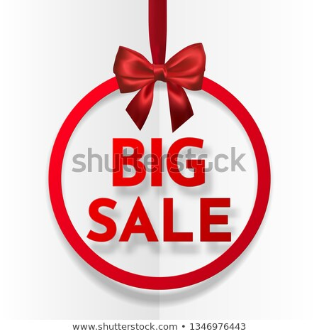 Big sale. Bright holiday round frame banner hanging with red ribbon and silky bow on dark background Stock photo © olehsvetiukha