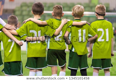 Youth Junior Soccer Team. Boys Standing in a Row and Watching Penalty Kicks During Extra Time Stock photo © matimix