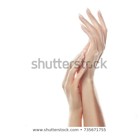 closeup of beautiful woman hands with light manicure on nails on a gray background massage of hands stock photo © artjazz