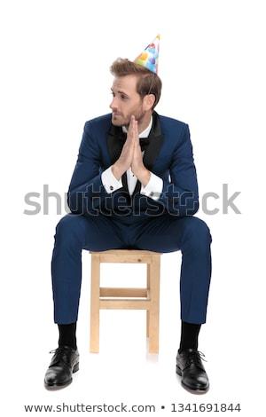 сидящий любопытный человека рождения молиться Сток-фото © feedough