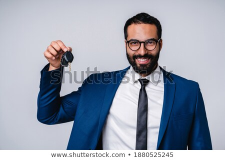 Image of adult arabic businessman 30s in formal suit holding pal Stock photo © deandrobot