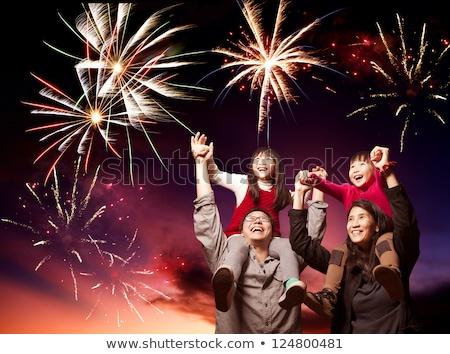 Happy family celebrate Chinese New Year look at Chinese red lanterns Stock photo © galitskaya