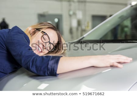 Car seller woman hugging car at the garage Stock photo © Lopolo