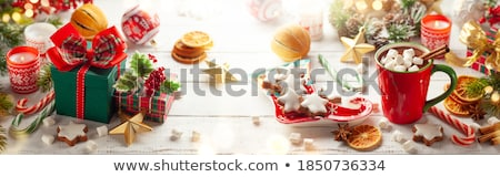 hot chocolate, christmas gift and candles on table Stock photo © dolgachov