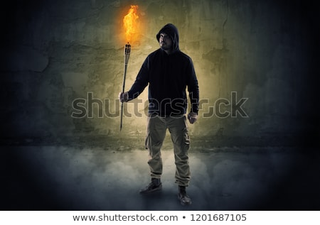 Wayfarer with burning torch in front of crumbly wall concept Stock photo © ra2studio