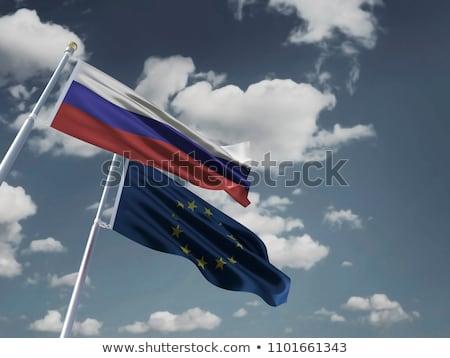 Europese unie Oekraïne vlaggen blauwe hemel Maakt een reservekopie Stockfoto © vapi