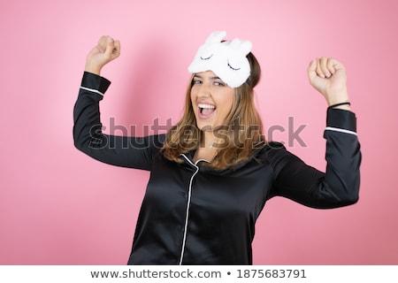 happy woman in pajama making sleeping gesture Stock photo © dolgachov