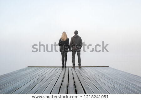 boy and girl hold each other for  hands on  footbridge Stock photo © Paha_L