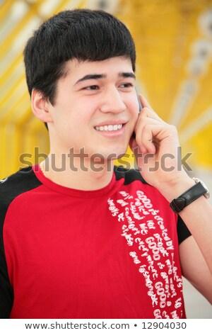 Jeune homme téléphone portable jaune passerelle bâtiment homme Photo stock © Paha_L