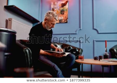 retro mustache man sitting in vintage sofa Stock photo © lunamarina