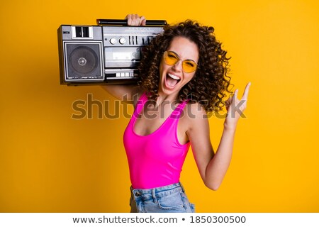Young woman with a cool rocker style listening to music  Stock photo © dacasdo