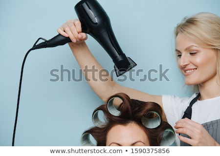 Woman with hair rollers Stock photo © photography33
