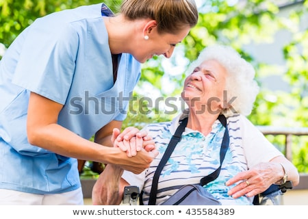 a nurse and an old lady in wheelchair Stock photo © photography33