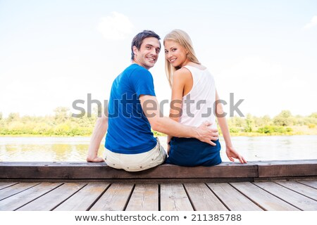 young couple sitting by riverbank Stock photo © photography33