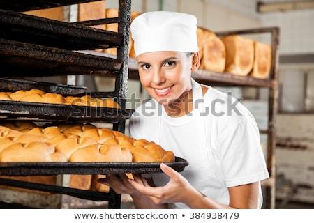 femenino · Baker · panadería · baguette · vendedora · frescos - foto stock © photography33