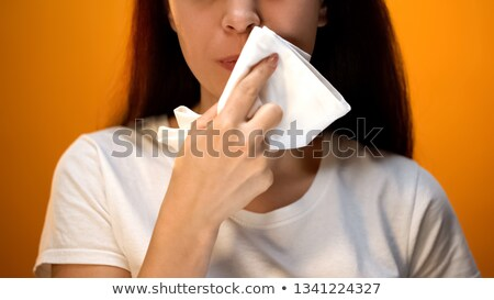 Woman wiping mouth with tissue Stock photo © photography33